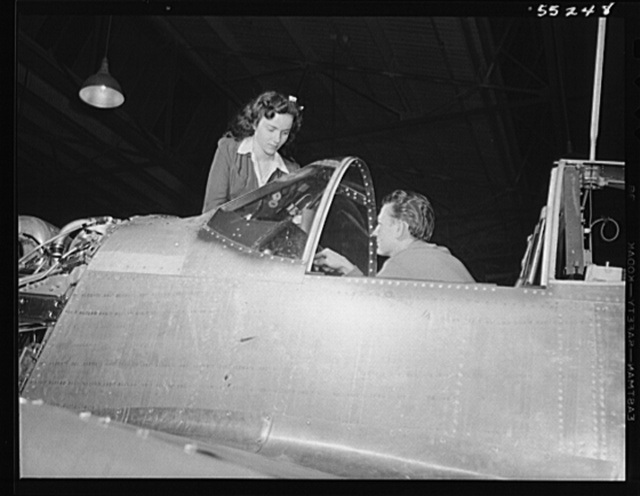 As in the sub-assembly departments, men and women work together in the final assembly of North American P-51 Mustang fighters