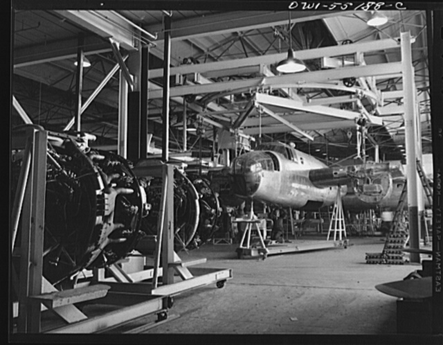 At the end of the overhead conveyer line an overhead turntable enables the forward and rear fuselage sections to be attached to the North American B-25 bomber before it moves to the final assembly line
