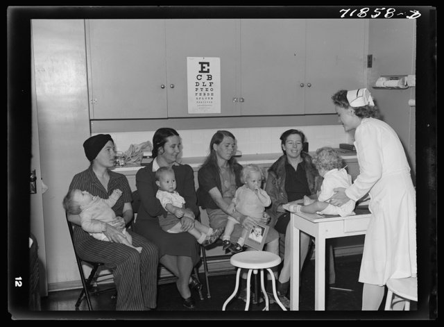 At the well baby clinic at the Cairns General Hospital at the FSA (Farm Security Administration) farm workers' community. The well baby clinic meets once a week and babies are weighed, measured, and others given instructions as to their care, feeding, etc. Three of those babies were born at the Cairns Hospital. Eleven Mile Corner, Arizona