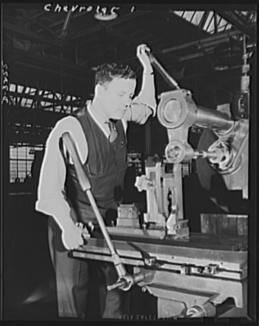 Auto conversion to airplane engines. With normal operations of this automobile factory suspended for the duration, the gigantic task of converting the entire plant to war production was taken over by the National Defense Plant Corporation. This involved all degrees of remodelling, the removal of old and installation of new machinery, and extensive rebuilding of the plant itself. An ex-automobile worker is pictured here operating a centering machine to determine the plain and stroke of an airplane engine crankshaft. Chevrolet, Buffalo, New York