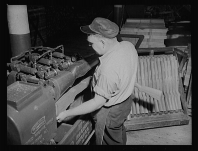 Automatic machines. Automatic machines have time and labor in the war program. This modern copying lathe takes a rough rifle stock and turns it to its final shape