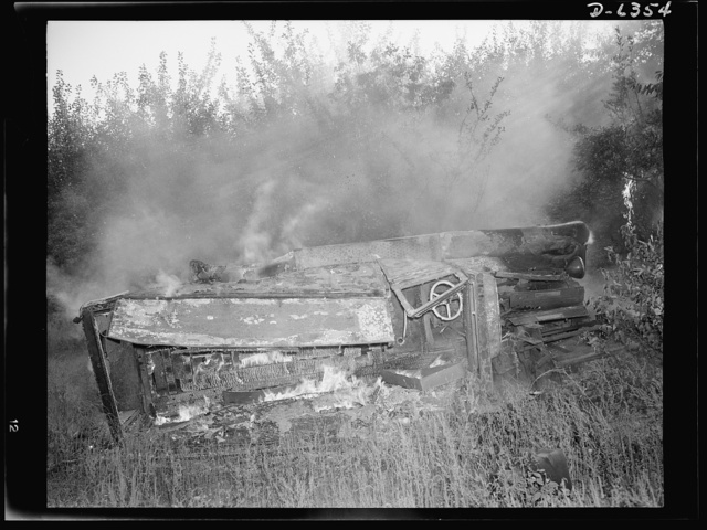 Automobile salvage. Before the torch men, shear men, and press operators go to work on an old automobile, all wooden parts, upholstery, oil, grease and other unusable and inflammable material are removed by burning