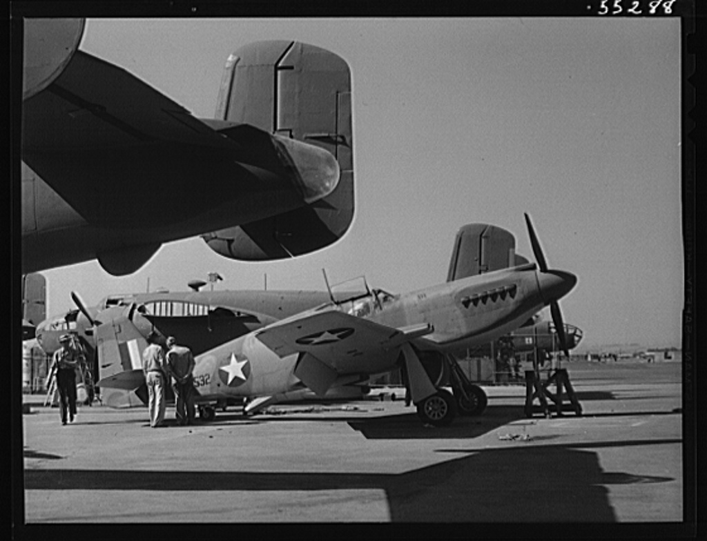B-25 bombers and P-51 fighters stand side by side on North American's flight ramp
