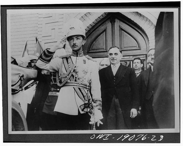 Baghdad, Iraq. Opening of the Iraq Parliament by the regent. The regent with the prime minister General Nuri as-Said on his left, receiving the salute of the guard of honour. The regent is wearing the Iraqi Field Marshal's uniform with the sash of the Order of al-Rafid-ain and the Hashimite chain. He is also wearing the Star of the Order of St. Michael and St. George recently conferred on him by His Majesty King George VI
