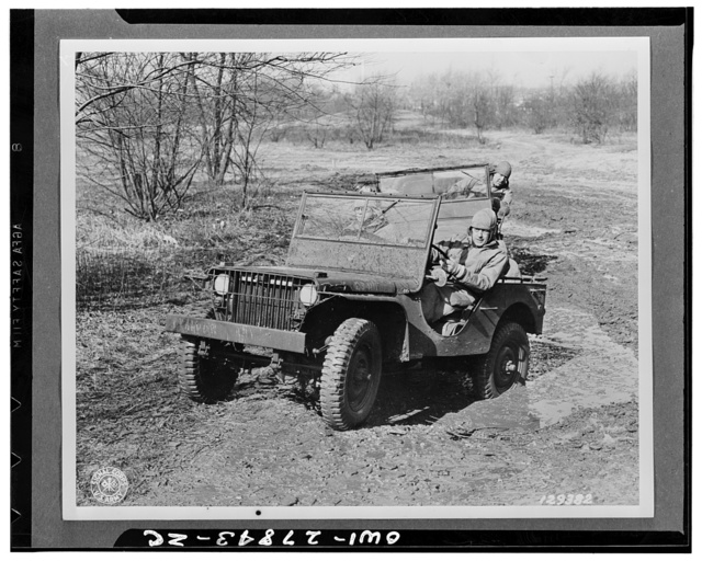 """Baltimore, Maryland. Colonel H.J. Lawes, post commander, Holabird quartermaster depot and commandant of the quartermaster motor transport school at the wheel of a """"jeep"""" giving his pupils first-hand instructions on the vehicle training ground during a two-week preventive maintenance for motor vehicles course for officers"""