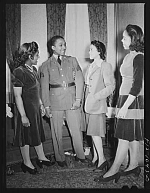 Baltimore, Maryland. Sargeant Franklin Williams, home on leave from Army duty, with his sister and his best girl Ellen