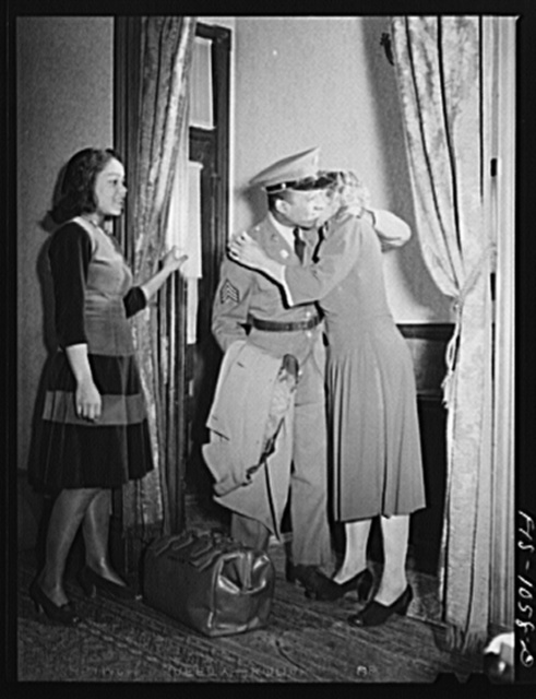 Baltimore, Maryland. Sargeant Franklin Williams, home on leave from Army duty, saying goodbye to his mother before leavng for Fort Bragg