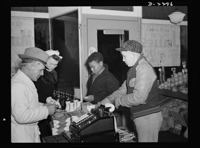 Bantam, Connecticut. Much of the food that is served in Bantam homes is bought at the local First National Store, part of New England's leading food chain. Manager Charley Dempsey, who admits that he sometimes takes off his hat when sleeping, hopes soon to get a larger store with a full line of meats, but is worried about the difficulty in getting meat cases. He's very pleased about the increase in his business, which has meant larger weekly checks for him, and has increased his staff from one boy part-time two years ago to three full-time and one part-time now. He looks for an even greater volume when the second forty units of the new housing project are completed. Charley, who was in the Army during the last war, and all his employees are natives of Bantam. The main difference rising food prices have meant to Bantam housewives, says Dempsey, is that whereas they used to order without bothering to ask the price, they now ask the price, then say what they want