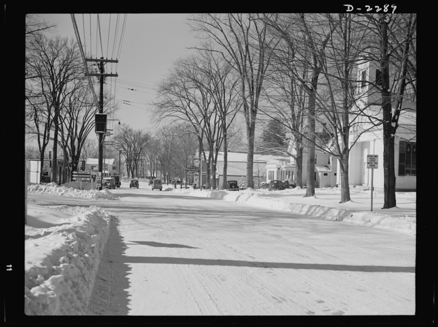 Bantam, Connecticut. The business section of Bantam with the camera facing south along Lafayette Boulevard (Route 25). A few rods to the left is the Warren McArthur plant, while the block of stores visible at the left includes Mitchell's Tavern, the First National Store, a garage and two service stations. Not shown, but lying just this side of Mitchell's restaurant is the birthplace of Horace Bushnell, a discoverer of anaesthesia. Reading from the right are the Espiscopal Church, Tony's Bantam Inn, favorite eating place, Marcel Roy's drugstore, the Bantam grocery store and the firehouse