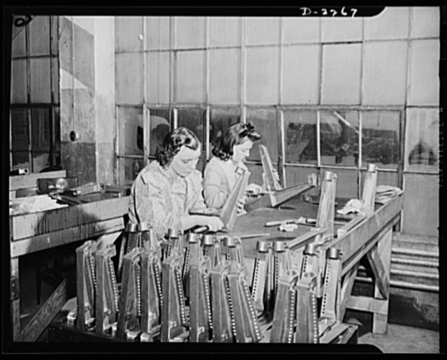 Bantam, Connecticut. Two Bantam girls are seen here burring aluminum castings for aircraft seats at the Warren McArthur plant. At the left is Marion Jefferies, who has been doing this work since December 1940. Jean Brunetto is the daughter of Mike Brunetto, who operates a popular dine-and-dance place in Bantam. Mike came to Bantam twenty-six years ago from New York, and was a barber until 1930, when he became an inkeeper