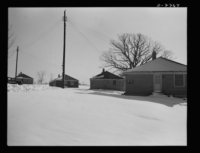 Bantam, Connecticut. War workers' homes. The war has brought approximately a thirty-three percent increase in housing facilities in Bantam--an eighty-unit federally financed housing project about five minutes from the Warren McArthur factory. The first forty units--two to a house, were occupied in early January 4, 1942 and the second forty had already been rented pending completion. As the automobiles and tires of workers in Bantam's defense industries wear out, it is probable that additional new housing facilities will be needed