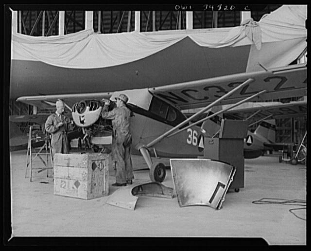 Bar Harbor, Maine. Civil Air Patrol base headquarters of coastal patrol no. 20. Ground crew making a routine check on a patrol plane
