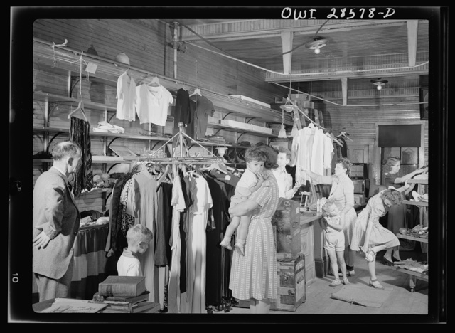 Bargains are the keynote at the Hardwick victory store and here are seen some of the women folk who know a bargain when they see one. Because it helps the war effort, it makes the buying just that more keen