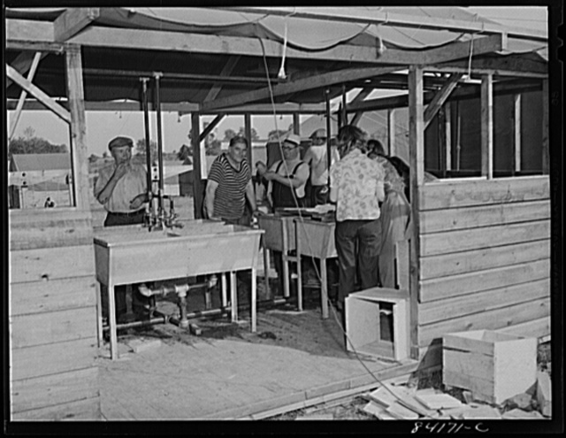 Batavia, New York. Elba FSA (Farm Security Administration) farm labor camp. Migrants from both New York City and West Virginia washing up after work