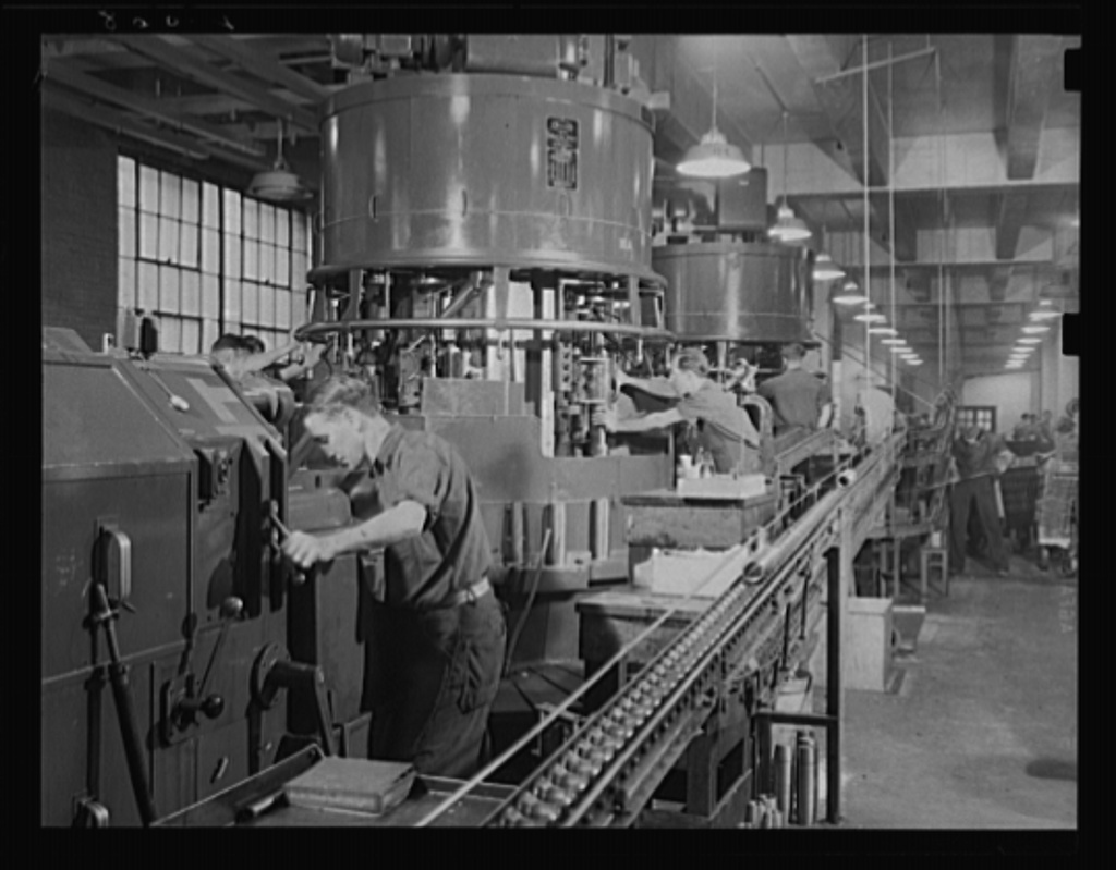 Battery of machines to arm batteries of guns. Both ends of the 75 mm shells are worked at once on these multiple spindle machines in a large eastern arsenal