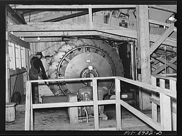 Ben Bow chromite mill, Stillwater County, Montana. The Oliver filter where the concentrates after the tabling process are separated from the water which they contained; the residue is then partially dried and is ready for shipment