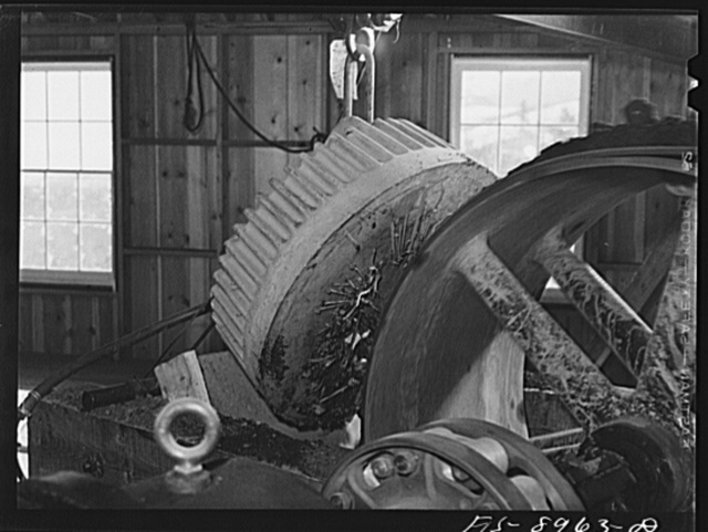 Ben Bow chromite mine, Stillwater County, Montana. Metallic articles are removed from chrome ore by a magnet at the end of conveyor belt