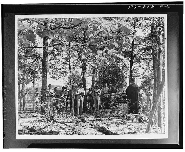 Beneath the branches of trees, Second Army soldiers, now participating un the Tennessee maneuvers, attending religious services