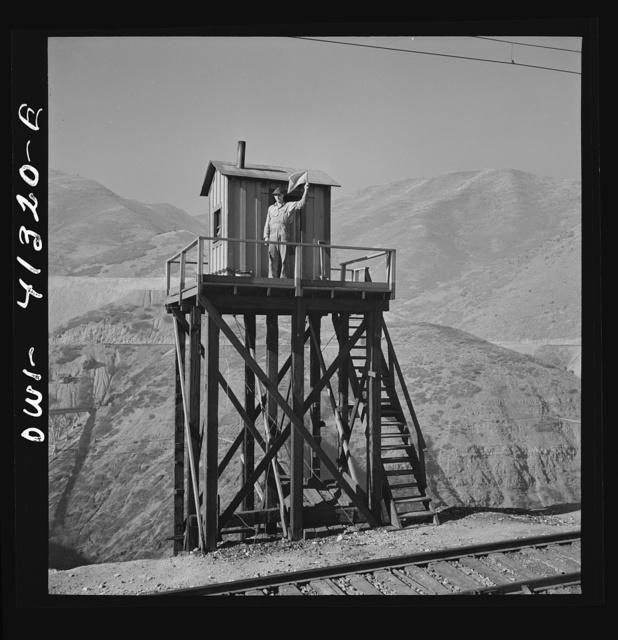 Bingham Canyon, Utah. Signalman of the Utah Copper Company at its open-pit mine workings