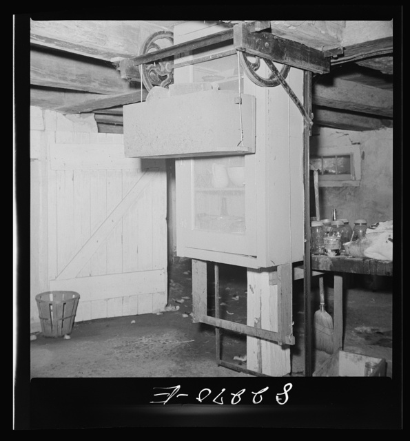 Blue Ball, (vicinity). Lancaster County, Pennsylvania. Dumbwaiter food safe which descends into the basement when not needed. Amish FSA (Farm Security Administration) client's home