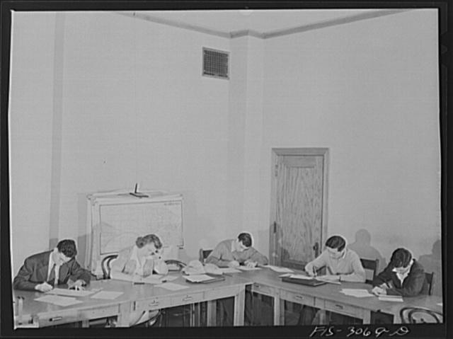 Bob Aden (center), taking an examination in economics seminar class. University of Nebraska, Lincoln