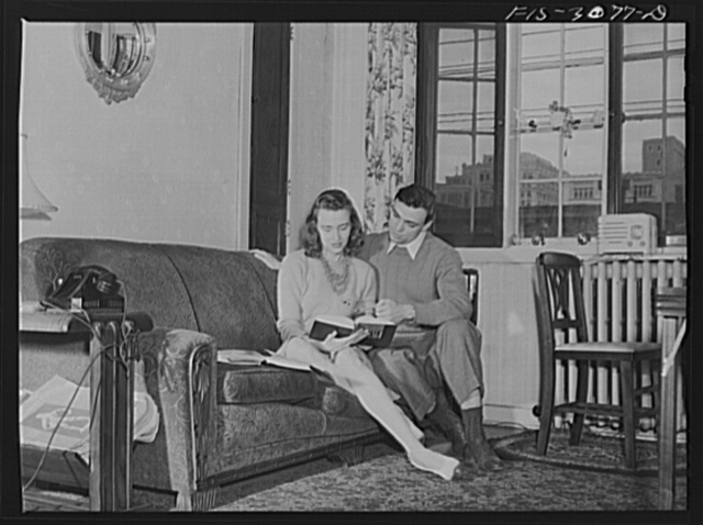 Bob Aden studying with his wife in their apartment. University of Nebraska, Lincoln