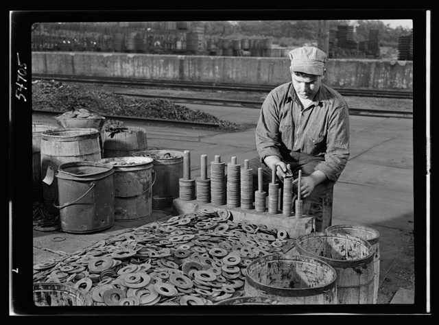 Boston and Maine railroad shops at Billerica, Massachusetts. Sorting iron washers according to size. Many of these will be used over and over again