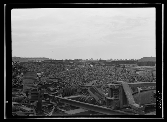 Boston and Maine railroad shops at Billerica, Massachusetts. Tremendous piles of spikes will be sorted out according to size and put away in kegs for salvage purposes