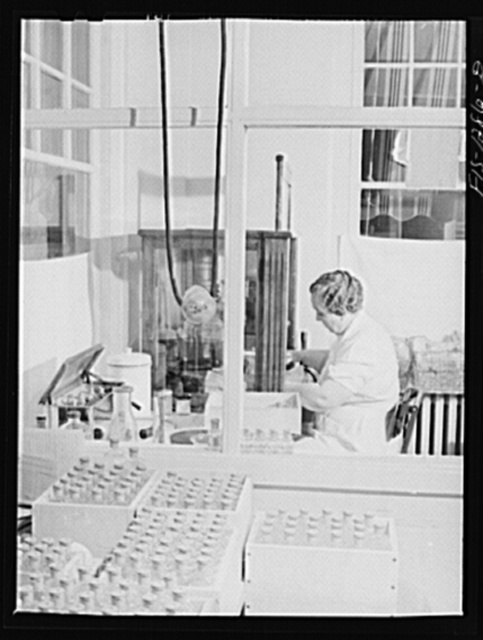 Bottling eight cubic centimeter quantities of typhus vaccine for shipment. USPHS (United States Public Health Service)  Rocky Mountain Laboratory, Hamilton, Montana