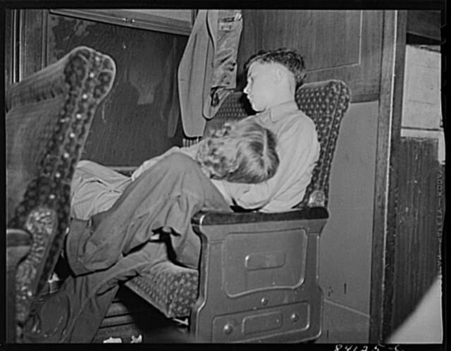 Boy and girl, en route to Batavia, New York from Richwood West Virginia to upper New York state to work in the harvest