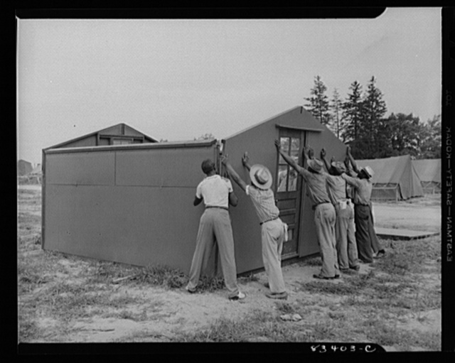 Bridgeton, New Jersey. FSA (Farm Security Administration) agricultural workers' camp. Putting up a prefabricated house made from materials not affected by wartime shortages
