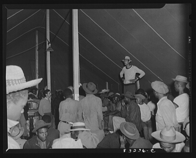 Bridgeton, New Jersey. FSA (Farm Security Administration) agricultural workers' camp. Assistant supervisor of the government camp addressing the migrants who have just arrived from Florida