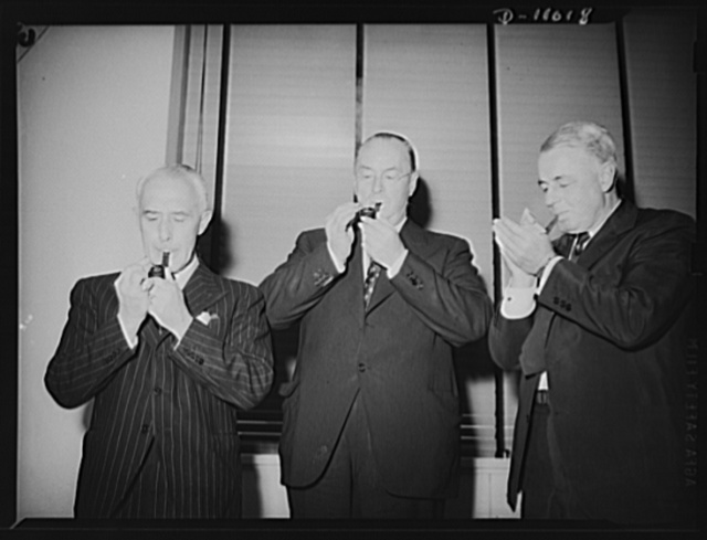 British and American Production and Resources Board. British and American members of combined Production and Resources Board at press conference held July 31, 1942. Left to right: Sir Robert Sinclair, Captain Lyttleton's deputy on the board; Donald M. Nelson, board member; J. S. Knowlson, Mr. Nelson's deputy on the board