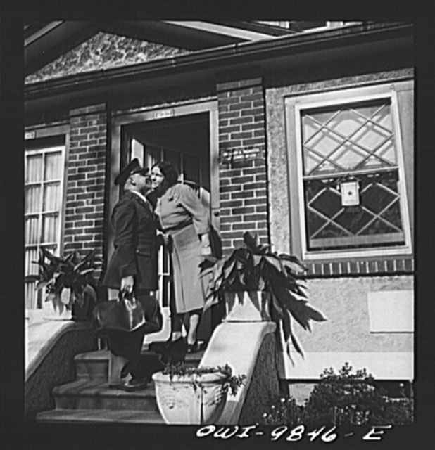 [Brooklyn, New York. A section of the city largely inhabited by Finnish-Americans, near Thirty-ninth Street and Eighth Avenue, known as Finn Town. Lieutenant Palmrose, American-born Finn at doorstep of home of woman who has a service star in the window]