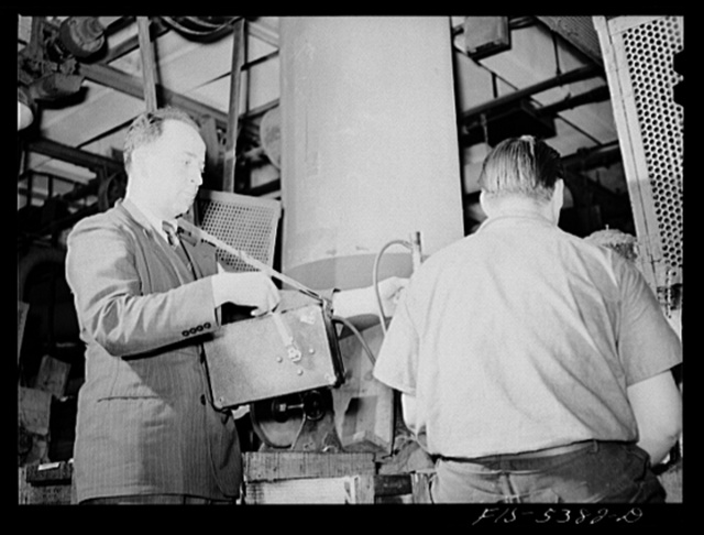 Brooklyn, New York. Industrial hygiene specialist testing a factory for injurious gases