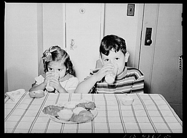 Brooklyn, New York. Red Hook housing development. Annette and Jimmy Caputo drinking milk