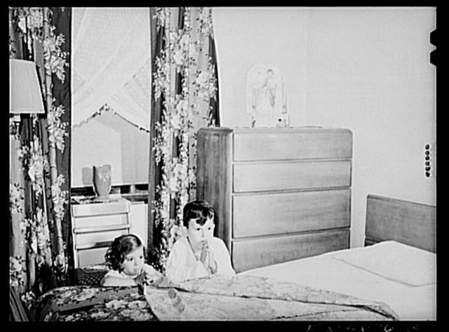 Brooklyn, New York. Red Hook housing development. Jimmy Caputo, seven years old, and Annette, three years old, at their nightly prayers