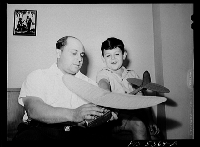 Brooklyn, New York. Red Hook housing development. Jimmy Caputo showing his father a model airplane