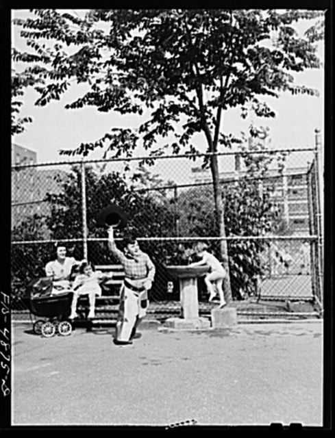 Brooklyn, New York. Red Hook housing development. Mrs. Caputo and Annette watch Jimmy playing cowboy