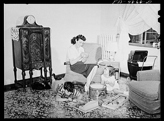Brooklyn, New York. Red Hook housing development. Mrs. Caputo and her children in the living room of their four-and-a-half room apartment for which they pay five dollars and thirty-five cents weekly