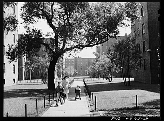 Brooklyn, New York. Red Hook housing development. Mrs. James Caputo, Jimmy and Annette walking through the project