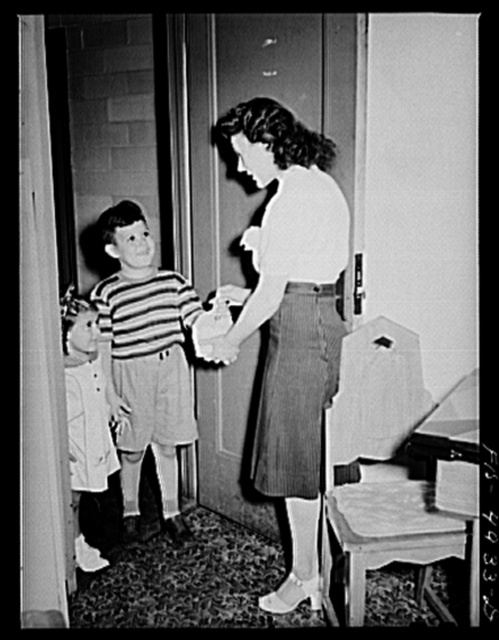 Brooklyn, New York. Red Hook housing project. Jimmy and Annette Caputo returning after having gone on an errand for their mother
