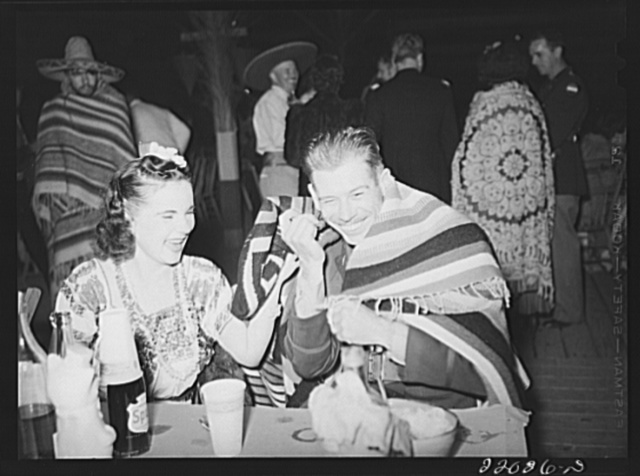 Brownsville, Texas. Charro Days fiesta. Army officer in a Mexican mood. Dance at El Rancho Grande