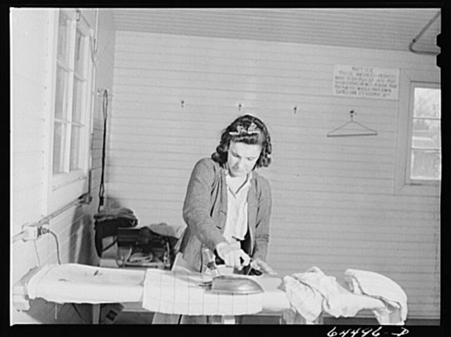 Burlington, Iowa. Acres unit, FSA (Farm Security Administration) trailer camp. Women ironing in utility building for workers at Burlington ordnance plant