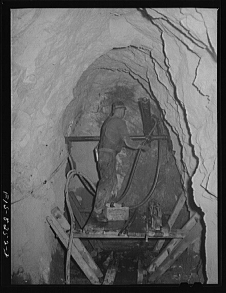 Butte, Montana. Anaconda Copper Mining Company. Drilling in the ore body of a copper mine