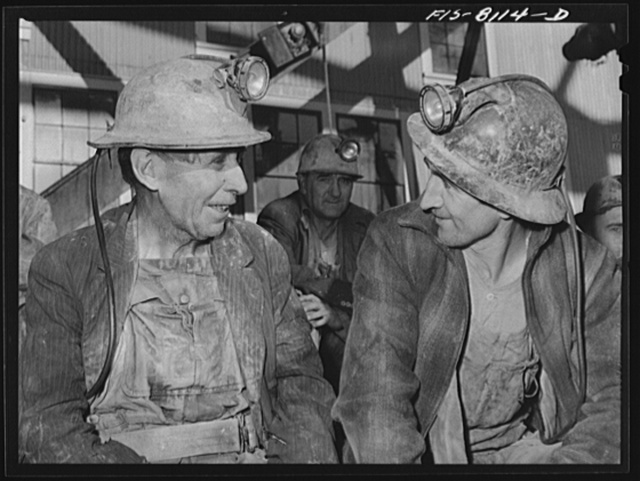 Butte, Montana. Anaconda Copper Mining Company. Miners on the surface waiting to go down in the cage