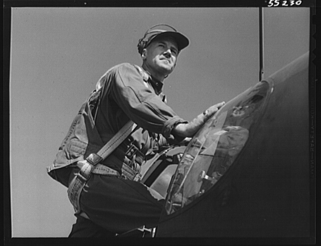 Captain B.R. Eckstein, Army Air Force's representative at North American climbs into a P-51 Mustang fighter for a final test before acceptance by the Army Air Force