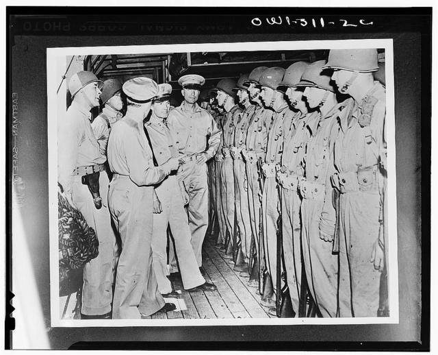 Captain Charles Paul McFeaters, commander of the transport; Rear Admiral Kelly Turner; Vice Admiral Robert Lee Ghormley; Major General M.F. Harmon, commander of the Army forces in the South Pacific area; and Major General Alexander M. Patch. Jr., inspecting the troops of the Army Task Force aboard the transport which is taking them from New Caledonia to the Solomons