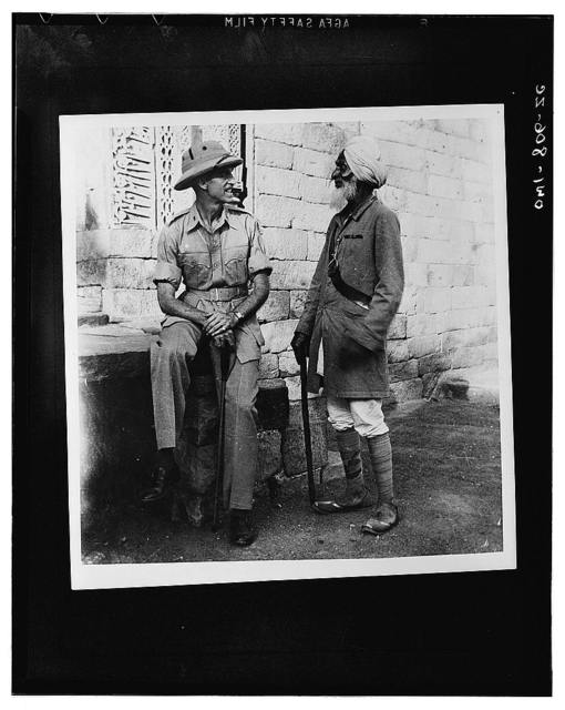 Captain James W. Snyder, Army intelligence officer, who was an historian in civilian life, with a veteranguide somewhere in India. The guide served in China during the Boxer rebellion. The ribbon he is wearing is for service with the late Lord Kitchner. He also served under Lord Roberts