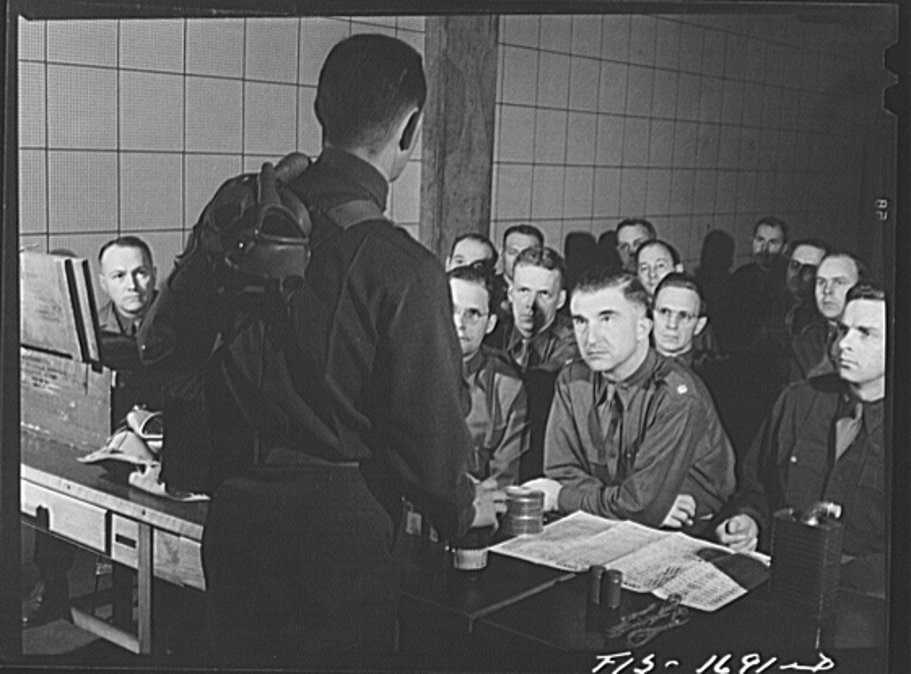 Captain William W. Kitchen instructing a chaplain school class in gas warfare and the use of gas masks. U.S. Army chaplain school. Fort Benjamin Harrison, Indiana